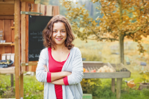 Woman smiling in front of her social enterprise