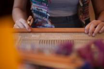 Artist at loom