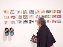 At the Emerge Festival 2019 showcase of art by Downtown Eastside Small Arts grants recipients, a woman looks at the artwork on the walls.