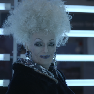 A screenshot from film, Empress of Vancouver showing local drag icon, Oliv Howe