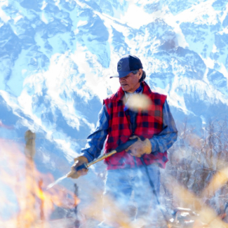 Yunesit'in First Nation member working a controlled burn
